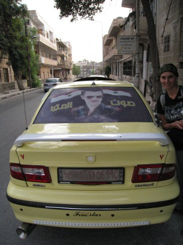 Kathryn posing with the Syrian President. 9 out of 10 cars have him plastered to the back window.