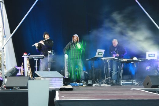 The middle dude was playing a synth using lasers. Awesome!