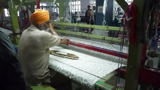 Weaver at Gians family's factory
