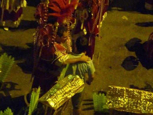 Tegan mingling with dancers at Carnaval Parade in Floripa