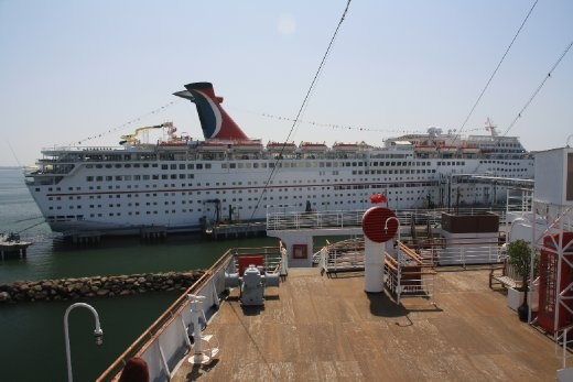 Old Cruise ship meets new - Yes, there is a water slide on that boat!