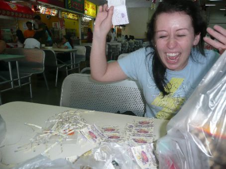 Erin showing our excitement of filling in 100's of raffle tickets that we got because we spent so much at the store.