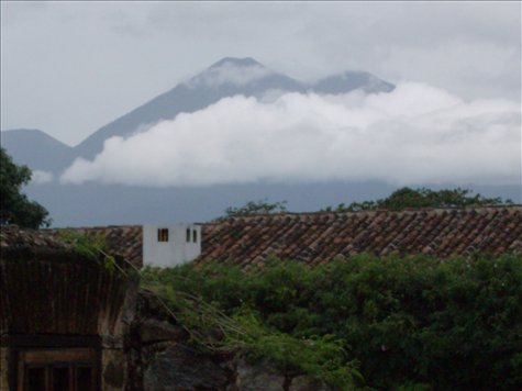 Volcanoes above the red tiled topped houses Antigua