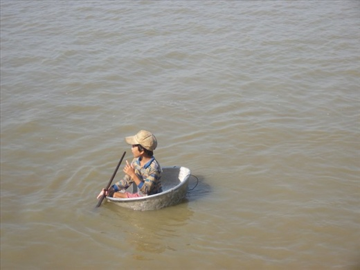 pot boy somewhere outside of Kratie, Cambodia on the Mekong river; how many peop