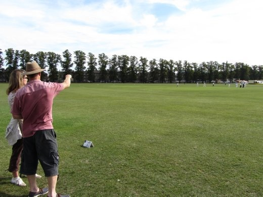 Richard teaching Anna the rules of cricket