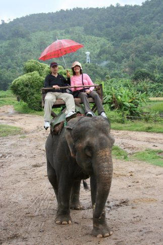 Us riding an elephant in the rain