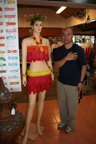 Ryan with a mannequin dressed in a condom bikini at Cabbages and Condoms! restaurant