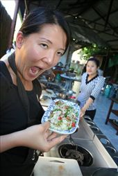 Felicia making funny faces at her dish. See our instructor in the background? =P: by traveling_jungs, Views[442]