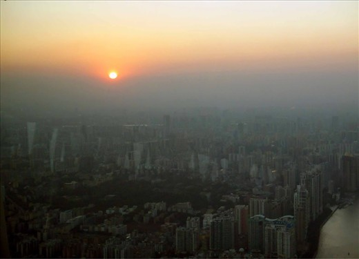 From the Canton Tower in Guangzhou I saw the sun setting into pollution before it disappeared beyond the horizon. Lenient environmental regulations are destroying the health and vitality of China's air and water supplies.