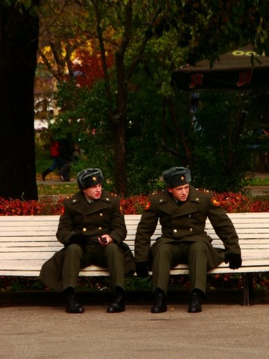 Some Russian police officers sitting around enjoying the lovely autumn day