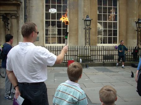 A busker caught our attention as we stopped for a cuppa outside the Pump Room of the Baths. Somehow Ian always gets invited to participate. He demonstrated his throwing skills with a flaming torch.