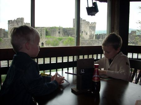 As usual, lunch before sight seeing. The local pub had a great view of the castle. The boys made up a game with the coasters while waiting for lunch.