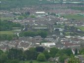 Caerphilly Castle as viewed from the mountain lookout just to the South. You can see how the castle is actually surrounded very closely by town, even though you don't get a sense of that when you are walking around it.: by tregenza_family, Views[197]