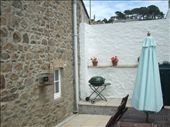 Cosy little courtyard attached to the house....no views but a great sun trap!: by tregenza_family, Views[195]