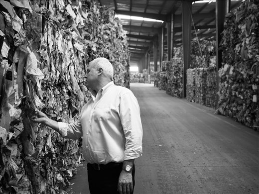 A waste paper exporter from Australia inspects material at a storage shed in Fuyang