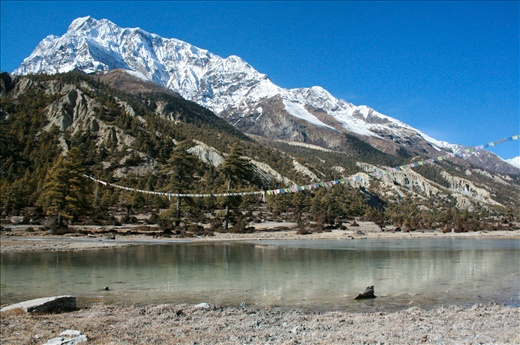 Mount Annapurna and drying dhukur lake during the winter with few snows.