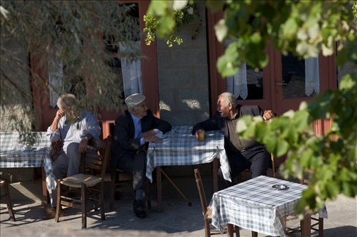 Old people drinking coffee early in the morning, at the main road of Pentalofos