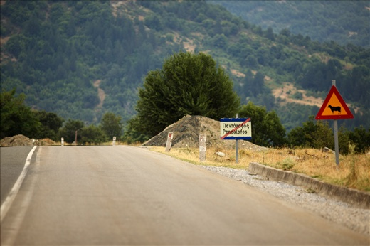 Pentalofos main road and the sign that marks the end of the village area.