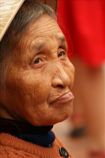 The hard life of an elderly Vietnamese lady is written on her face
