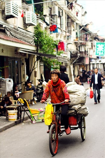 Many workers in China still use bicycles for their work, often these jobs can be quite heavy
