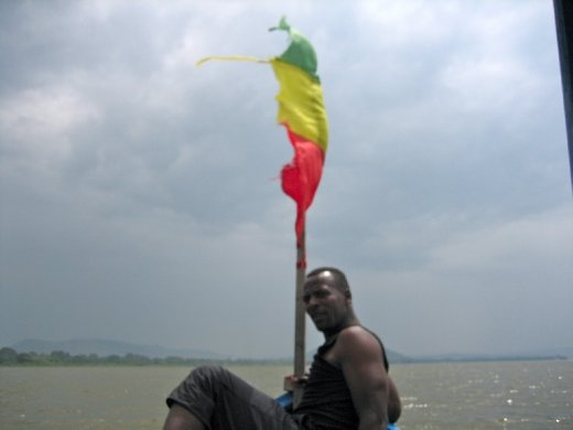 Boat guide posing with the Ethiopian flag.
