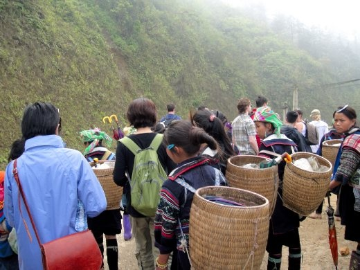 Black Hmong women hiking with all the tourists