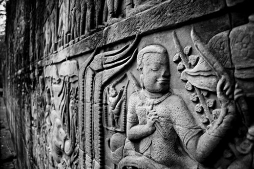 -The Way We Were- Whilst back in Cambodia for another volunteer mission trip I wanted to capture the charm and wonder of Cambodia while also capturing the harsh poverty that went alongside it. This is a picture of some of the wall carvings in one of the temples in Angkor Wat in the Siem Reap province of Cambodia. There are hundreds of temples in this region which are a remnant of the once glorious Khmer Empire. Quite a contrast to how the country is now; still struggling over thirty years after Pol Pot's Khmer Rouge regime decimated this nation.