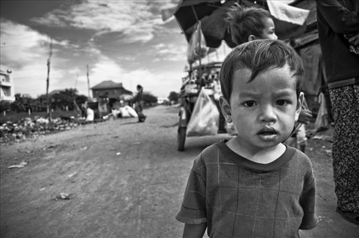 -The Hope for a Future- Cambodia is a beautiful country with a rich, and unfortunately bloody, history. This is a picture of a young boy who lives in the slum near the rubbish dump. Cambodia has a lot of help and aid from both inside the country and outside, and it all makes a difference, but stories like this boy's are still all too common. There's still a long way to go.