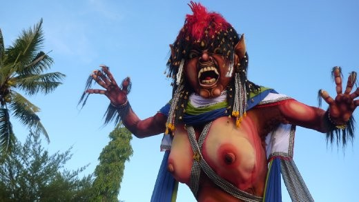 An 'Ogoh-ogoh' made of paper mache, believed to be possessed by evil spirits. In procession before being set alight