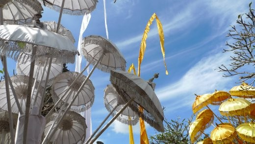 Umbrellas forming part of the temple decorations at Kuningan