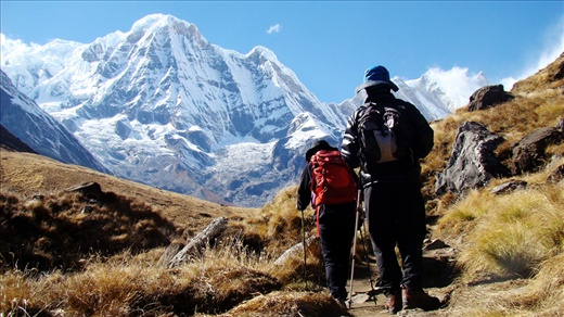Trekkers walk their final steps to reach Annapurna base camp (4,130m) – one of the most visited trekking destinations in Nepal. The most popular time to trek in Nepal Mountains are late spring (March and April) and early to mid-fall (October and November).