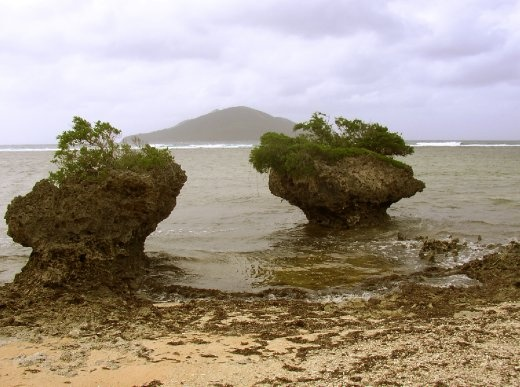 The fine white sand beaches are usually very bare. I found this wonderful shot with twin rocks and an island in the background that I tought looked remarkable