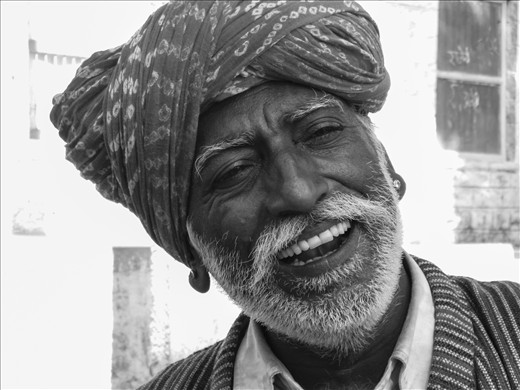 Musician playing the harmonium with all his joy in the middle of the Jaisalmer desert. Indian music is the most authentic sign of their ancient connection with their ground and their deep roots. So simple, rich and complex.