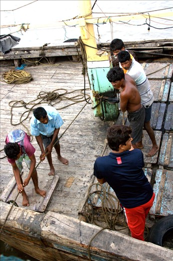 The fishermen trying to dock their boat