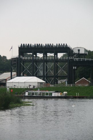 This is a boat lift. It raises and/or lowers narrow boats from the canal to the river - 53 feet or about 17 metres. It has been restored recently