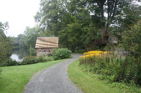 The boathouse and treehouse in the grounds of Clowance