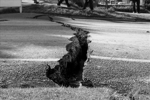 A Gaping hole on the road reminds people of their fragile existence