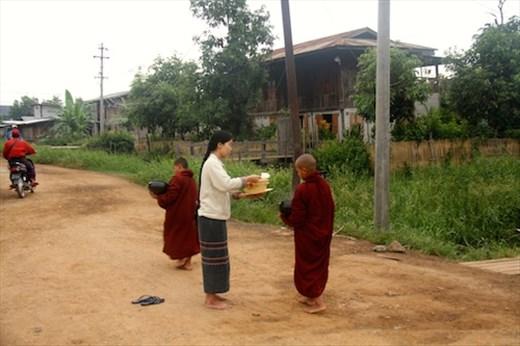 Receiving morning alms, Nyaung Shwe