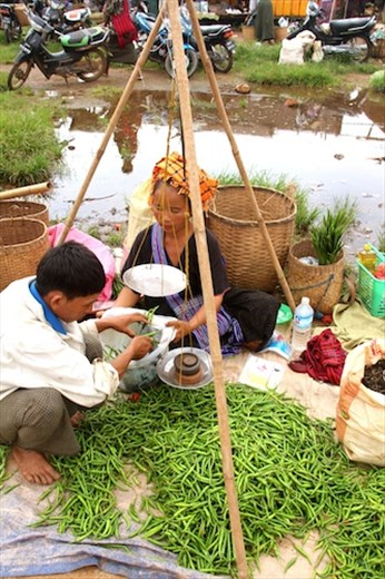Weighing a hill of beans, Inthein market, Inle Lake
