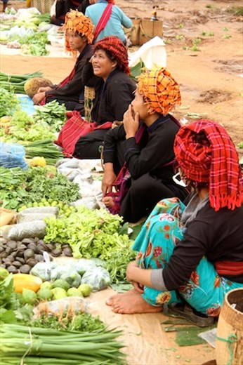 Different colored turbans for each village, Inthein market, Inle Lake