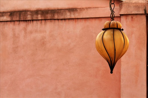 4. a simple hanging lantern reminds  the Arabian influence  of the city and its past as a connection bridge between central Europe and the Orient. And behind again a colourful wall , a variation on the reds, pinks and terracotta that are the theme of the earth colour of Venice