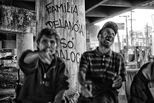Under the same bridge, many stay the whole day sitting on a sofa drinking pinga.