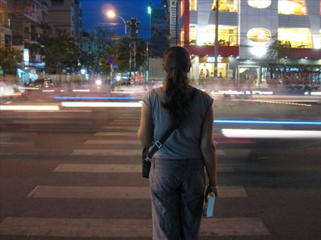 Sharan contemplating the safest way across in Saigon