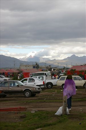Monica at the car market with Cotopaxi in the background