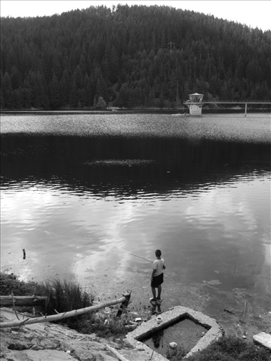 Childhood:  A local kid fishing at one of the greatest lakes in the region. The lake is a tourist attraction making it a bit easier for the locals to make their living.
