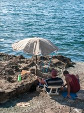 Cubans on the rocky beach by the Malecon in Havana, Cuba: by vincentdemers, Views[365]