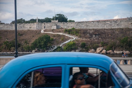 Cubans driving on the Malecon in Havana, Cuba