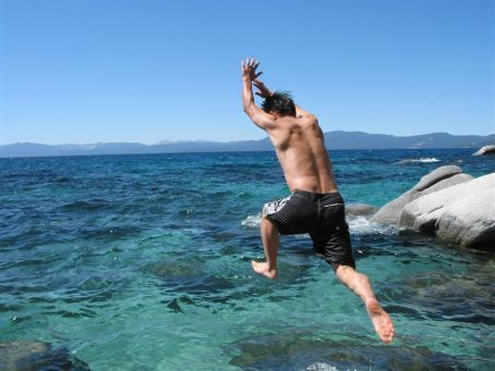 Jumping into the cold water of Lake Tahoe   very cold