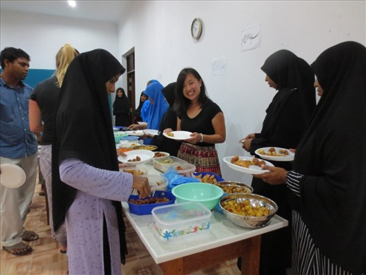 Breaking fast with the whole island community in the school hall. Everyone is invited to eat and celebrate together. A wide variety of dishes are made including grilled fish, curries, steamed bananas, leafy local salad, milk fruit desserts.