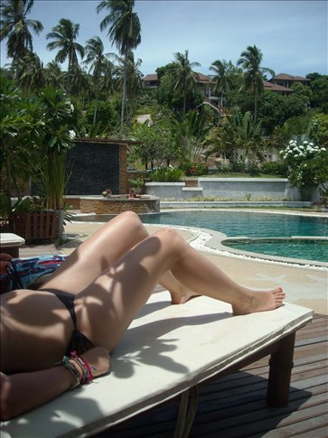 a very artistic photo by iona of vivienne - by the pool at our resort
